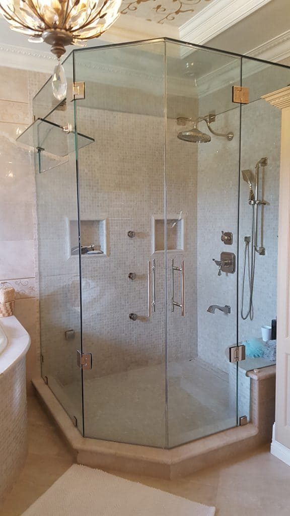 Master bathroom shower, double outswing glass shower door by Aldora, glass shower wall, walk-in shower, chrome accents