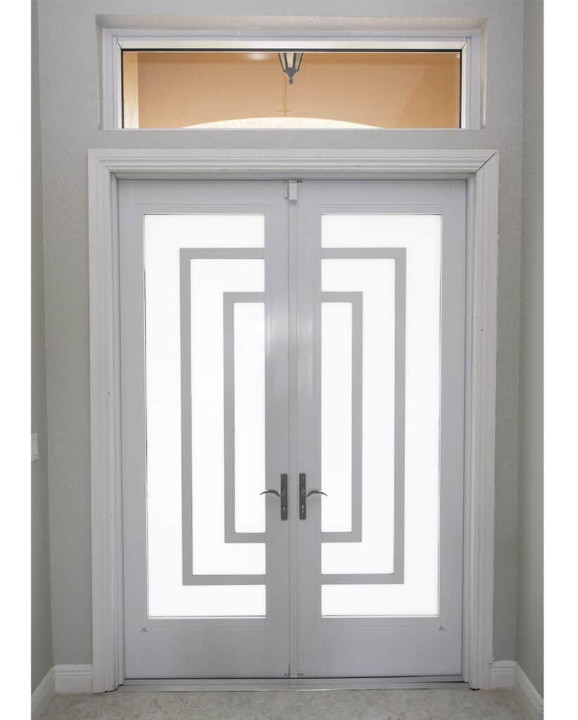 glass entrance door with white decorative frame